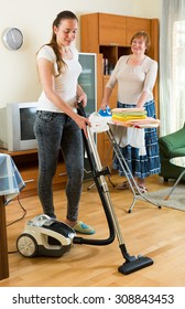 Daughter with mother clean at home together