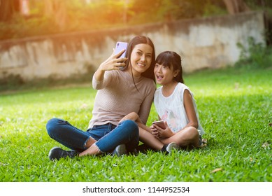 Daughter and mother are doing self park smiling.Happy Mother and daughter hugging