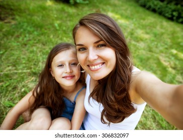 Daughter and mother are doing self park smiling