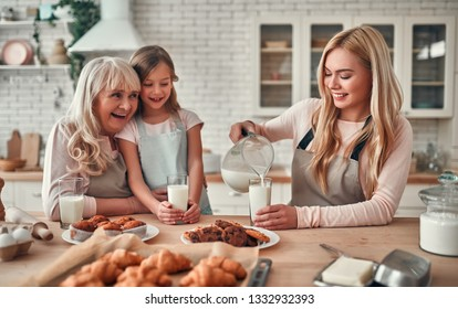 Daughter, mother and grandmother cooking on kitchen. Women generation baking together.