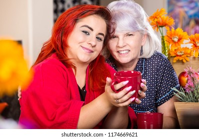 Daughter and mother look happy in kitchen