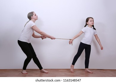 Daughter and mother. Manipulation in the family. Control. Childish egoism. The daughter holds the mother on the rope.