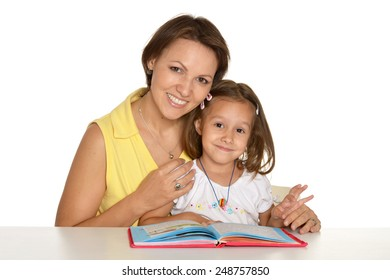 Daughter and mother read the book at home