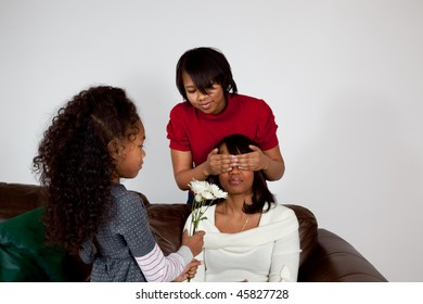 Daughter offering her mother a flower