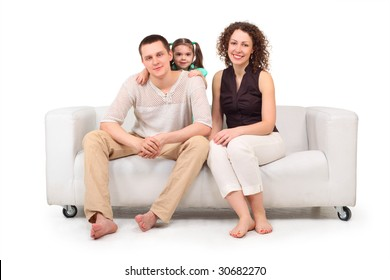 Daughter and parents on white leather sofa