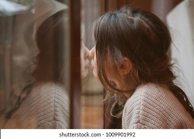 daughter reflecting sadness and loneliness at home
