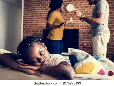 Daughter sad while her dad and mom are fighting