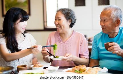 daughter and senior parent enjoy dinner in restaurant