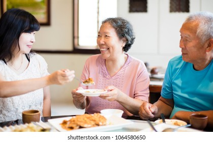 daughter and senior parent enjoy dinner in restaurant