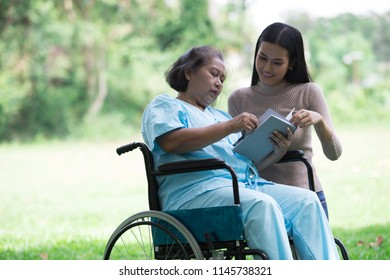Daughter, woman taking care of her grandmother.