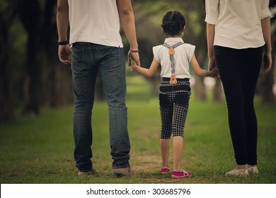 Daughters, parents were holding hands in the park