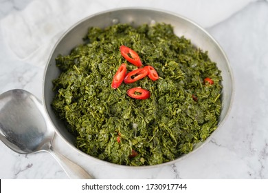 "Daun ubi tumbuk or daun singkong tumbuk  (Indonesian for ""pounded cassava leaves"") , made from pounded cassava leaves seasoning with shallot, ginger,red chili and garlic"