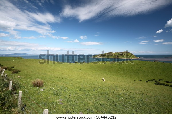 Davaar island and countryside from the south coast of Kintyre, Scotland
