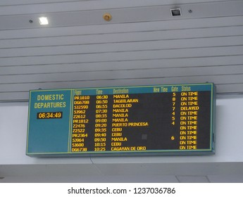 DAVAO CITY, PHILIPPINES—MARCH 2018: Digital flight status board for domestic flights at the Davao International Airport.