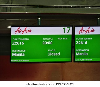 DAVAO CITY, PHILIPPINES—MARCH 2018: Digital flight status board of the Air Asia Airlines flights at the Davao International Airport.