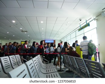 DAVAO CITY, PHILIPPINES—MARCH 2018: Passengers fall in line for boarding at the Davao International Airport.