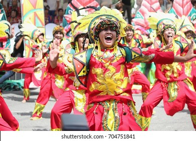 DAVAO CITY, PHILIPPINES--AUGUST 2014:Participating teams giving their best in performance at the streets. Kadayawan is celebrated August each year to give thanks for life and an abundant harvest.