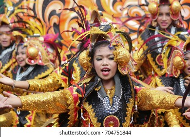 DAVAO CITY, PHILIPPINES--AUGUST 2014:Streetdancers in colorful costumes at the parade for the Kadayawan. Kadayawan is celebrated August each year to give thanks for life and an abundant harvest.