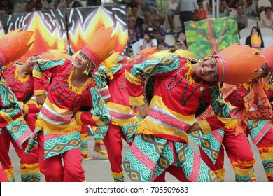 DAVAO CITY, PHILIPPINES--AUGUST 2014:Streetdancers in smiles as they perform at the streets of Davao.  Kadayawan is celebrated August each year to give thanks for life and an abundant harvest.