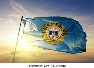 Davao del Norte province of Philippines flag textile cloth fabric waving on the top sunrise mist fog