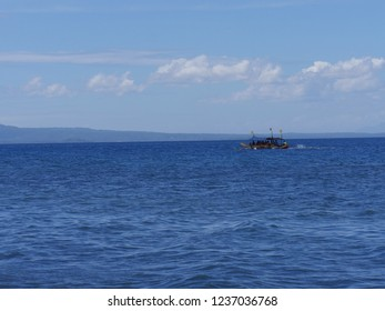 DAVAO NORTE, PHILIPPINES—MARCH 2018: Boaters enjoy the waters on a boat along the coast of Davao del Norte, southern Philippines.