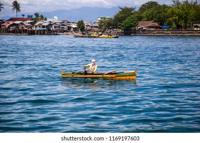 Davao, Philippines - Apr 26, 2018; Fisherman on traditional fishing boat in Davao sea, Philippines.