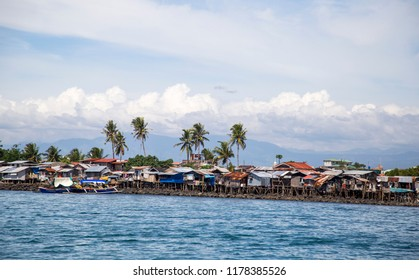 Davao, Philippines - Apr 26, 2018: Houses on stilts at the waterfront in Davao City, Philippines.