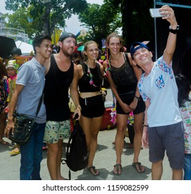 Davao, Philippines - August 18, 2018: Local having selfie with tourists during Kadayawan Festival 2018