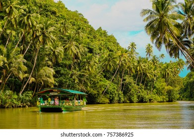 Davao's famous river, Loboc River and a boat that caters tourists with a lunch buffet.