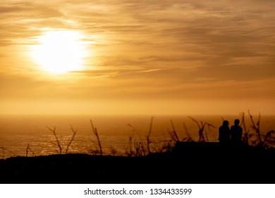 Davenport, California, United States of America- January 7, 2019: Romantic couple sunset
