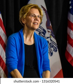 Davenport, IA/USA-02 10 2019: The day after launching her presidential camapaign, Elizabeth Warren participated in a panel discussion  in front of 1500 enthusiastic attendees on a snowy night