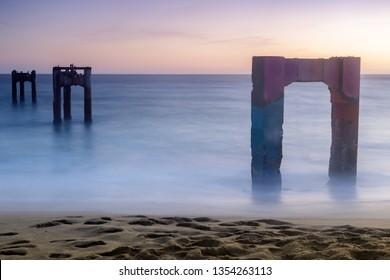 Davenport Old Pier Sunset with Long Exposure. Davenport, Santa Cruz County, California, USA.