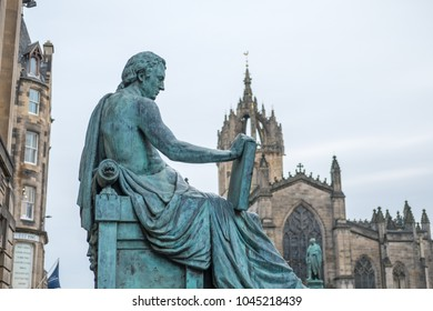 David Hume Statue with St. Giles Cathedral on the background on Royal Mile in Edinburgh, Scotland