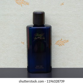 Davidoff Cool Water Eau de Toilette large perfume bottle in front of the satin wallcovering Elysee Kassel Germany 09.15. 2018 : Cool Water is a perfume for men developed by the perfumer Pierre Bourdon