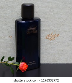 Davidoff Cool Water Eau de Toilette big perfume bottle in front of the satin wallcovering Elysee decorated with a rose Kassel, Germany, 09.15. 2018 : Cool Water developed by the perfumer P. Bourdon