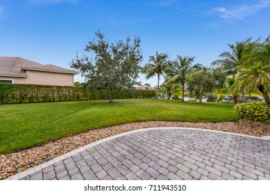 DAVIE, FL, USA: Backyard of a home with clean landscaping and views to a lake.