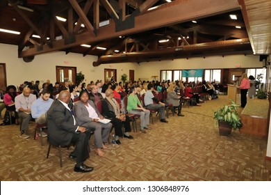 Davie, Florida / USA - January 30 2019: Broward County Census 2020 Kickoff meeting at Tree Tops Park during the presentation given by speakers in a large filled room by public and government people.