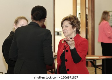 Davie, Florida / USA - January 30 2019: Broward County Census 2020 Kickoff meeting at Tree Tops Park Senator Commissioner Nan H. Rich speaking intensely to a member of the public and other officials.