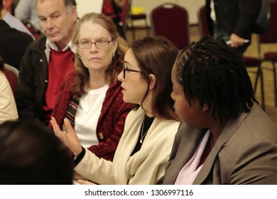 Davie, Florida / USA - January 30 2019: Broward County Census 2020 Kickoff meeting at Tree Tops Park young woman with glasses talking about the issues on the table.