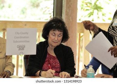 Davie, Florida / USA - January 30 2019: Broward County Census 2020 Kickoff meeting at Tree Tops Park older woman filling out a census 2020 form to be a volunteer being a document taker on the streets.