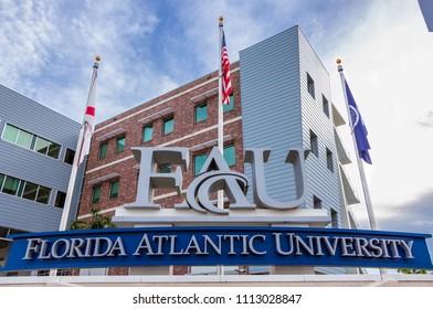 DAVIE, FLORIDA, USA - JUNE 14, 2018: Florida Atlantic University, Davie campus entrance sign with flags