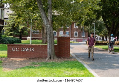 DAVIS, CA/U.S.A. - AUGUST 21, 2018: A photo of the original brick gate entrance to U.C. Davis, with unidentified students. The school started with a focus on agriculture that continues today.
