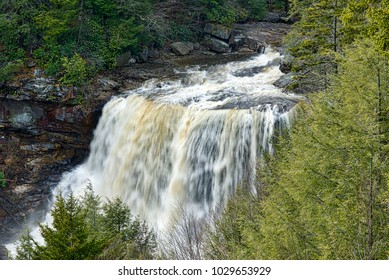 Davis, West Virginia - February 19, 2018: Recent heavy rain and snowmelt is evident as a deluge of water crashes over Blackwater Falls within Blackwater Falls State Park.