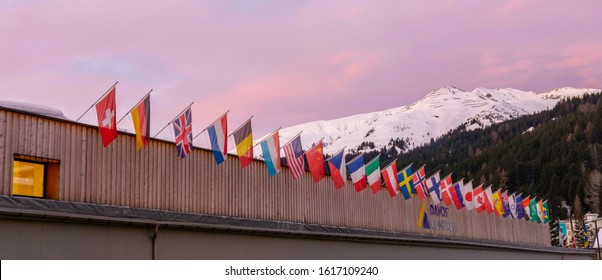 Davos, GR / Switzerland - 14 January 2020: the congress center in Davos with flags of nations at sunrise during the WEF World Economic Forum