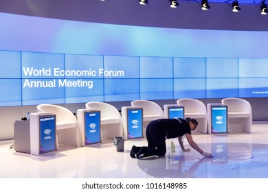 DAVOS, SWITZERLAND - Jan 26, 2018: Empty rooms before the debate begins at the World Economic Forum in Davos. Preparing a meeting room for world leaders. A woman from service staff washes the floor