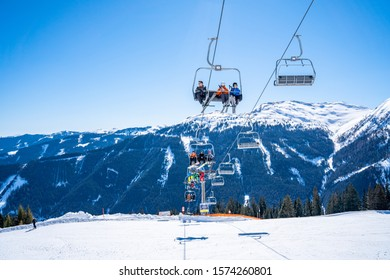 Davos, Switzerland. January 10, 2019. Mountain ski lift with seats going over the mountain and paths from skies and snowboards