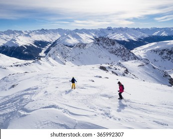 DAVOS, SWITZERLAND - JANUARY 12, A couple of skiers skiing downhil course in the Parsenn mountains, Davos, Switzerland, 2015