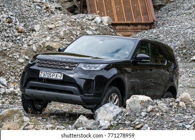 DAVOS, SWITZERLAND - OCTOBER 3, 2017: Land Rover Discovery 5 in the journey across Europe. Photo taken in the Alps in Austria, Switzerland and northern Italy.