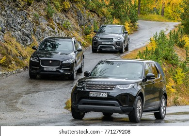 DAVOS, SWITZERLAND - OCTOBER 3, 2017: Jaguar F-Pace, Range Rover Evoque and Land Rover Discovery 5 made a long way to a mountain pass Umbrail in Switzerland.