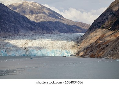 Dawes Glacier in Endicott Arm near Juneau Alaska. Rugged Mountains in the background. Afternoon sunlight hitting the glacier.